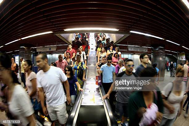 People ride an escalator at a metro station ahead of the FIFA 2014 World Cup Brazil on December 16 2013 in Sao Paulo Brazil