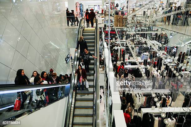 People ride an escalator inside an HM retail store during Black Friday events on November 25 2016 in New York City The day after Thanksgiving called...