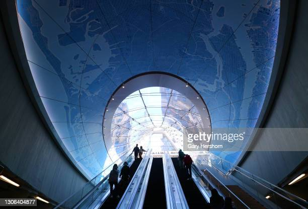 People ride an escalator inside the new entrance to Penn Station and the Moynihan Train Hall on March 10, 2021 in New York City.
