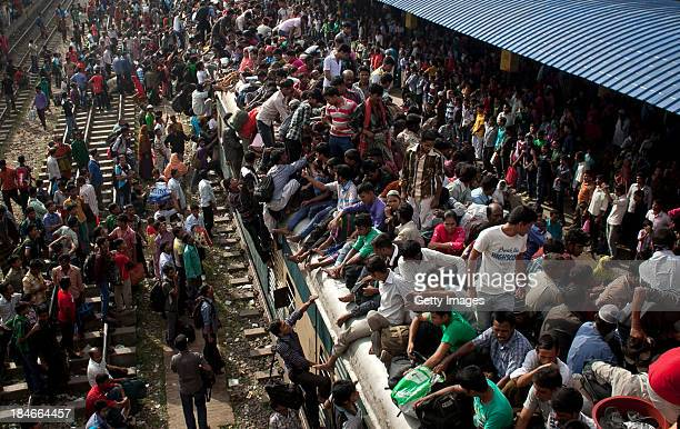 People ride an overflowing train at a railway station on October 15 2013 in Dhaka Bangladesh Eid AlAdha known as the 'Feast of the Sacrifice' is one...