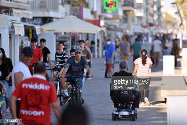 People ride and walk along Paseo Maritimo street during the end of the confinement of Phase One Calafell is in Phase One of the end of confinement...