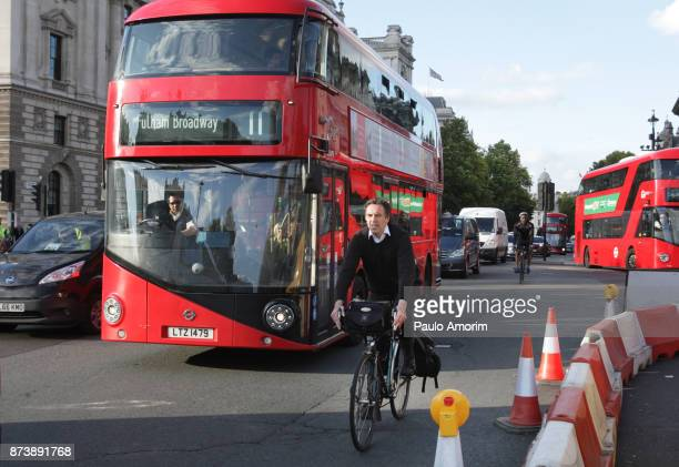 People Ride Bicycle on the street in London