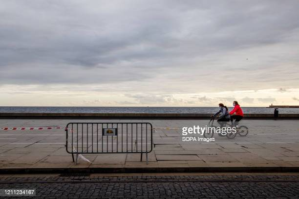 People ride bicycles along Matosinhos beach amid the Coronavirus pandemic According to the government of Portugal easing the lockdown is expected to...