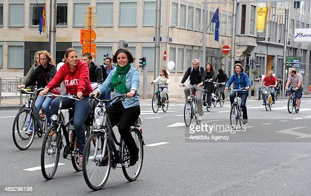 People ride bicycles in the streets of Brussels during the Car Free Sunday in Brussels Belgium on September 20 2015 Roads closed to cars or other...