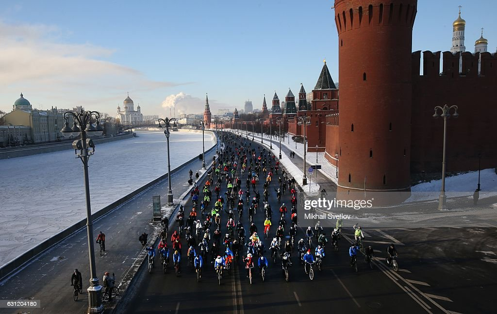 People ride bicycles near the Kremlin during the II Moscow Veloparade in Moscow, Russia, January, 1, 2017. Hundreds of muscovites attenended the Winter Bicycle parade and rode around 11 km in temperature as low as minus 24 degreees celcius (-12F). (