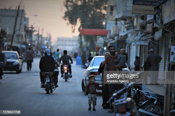 People ride bikes and walk at streets on the first year of Operation Peace Spring as life turned to normal in Tal Abyad Syria on October 13 2020 A...