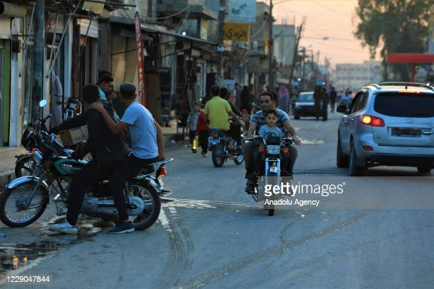 People ride bikes at street on the first year of Operation Peace Spring as life turned to normal in Tal Abyad Syria on October 13 2020 A year on...