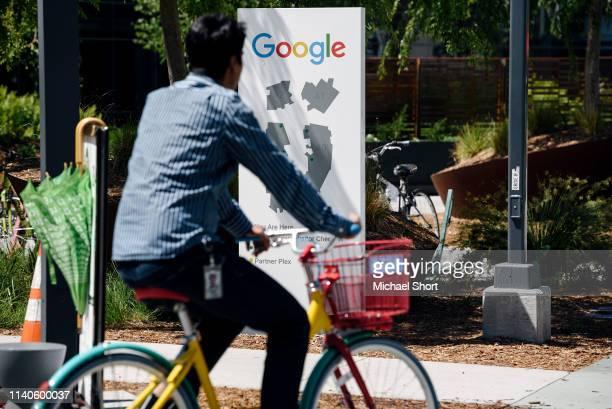 People ride bikes past signage on the Google campus as Google workers inside hold a sit-in to protest sexual harassment at the company, on May 1,...