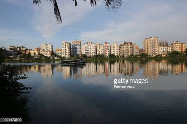 people ride boat on the lake in dhaka - dhaka stock pictures, royalty-free photos & images