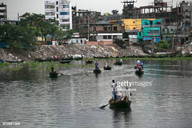 People ride boats on the Buriganga river June 10 2018 in Dhaka Bangladesh Bangladesh has been reportedly ranked 10th out of the top 20 plastic...