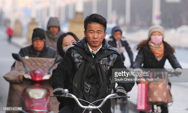 People ride electric bikes on Gangtie street in Baotou city, Inner Mongolia, on Nov. 18, 2017. The metro construction in Baotou city has been...