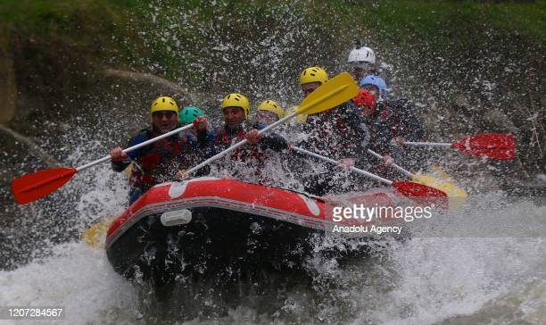 People ride in inlflatable boats as they do rafting down the Melen stream in Cumayeri district of Duzce Turkey on March 16 2020 Nature lovers coming...
