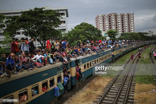 People ride on an overcrowded train as they rush home to celebrate Eidal Adha festival with their families and friends in Dhaka Bangladesh on August...