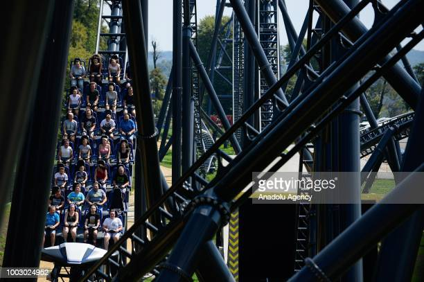 People ride on Hyperion the biggest Mega Coaster in Europe at Energylandia the biggest amusement park in Poland on July 21 2018 in Zator Poland...
