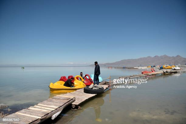 People ride paddle boats at Urmia Lake in Urmia Iran on April 6 2017 Urmia Lake was the largest lake in the Middle East and the sixthlargest...