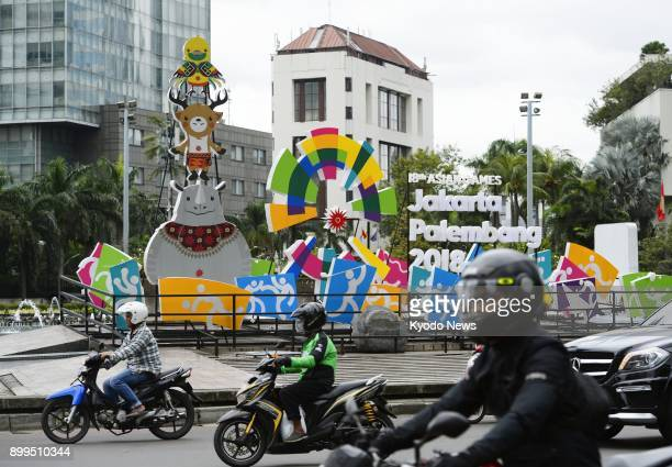 People ride past an installation in Jakarta on Nov 27 to promote the 2018 Asian Games in Indonesia ==Kyodo