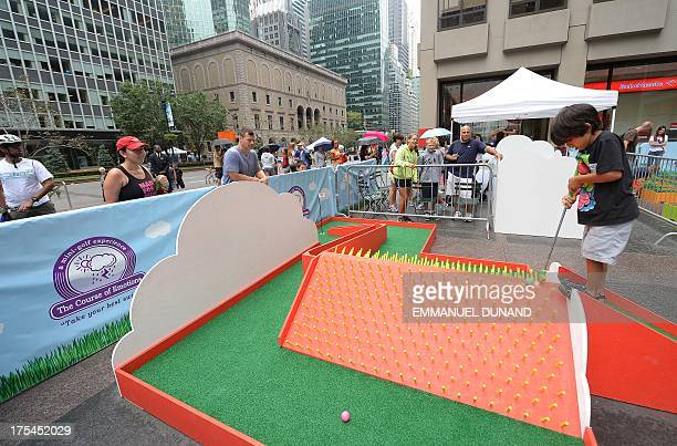 People ride play minigolf along a carfree Park Avenue during the Summer Streets event in New York August 3 2013 Summer Streets is an annual event...