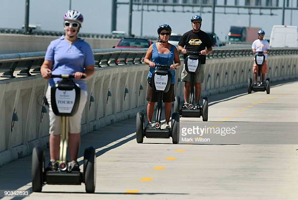 People ride Segways over the Woodrow Wilson Bridge on September 4, 2009 in National Harbor, Maryland. The American Automobile Association is...
