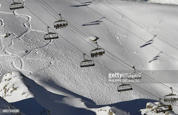 People ride the chairlift on December 21 2014 in the French ski resort of Val d'Isere in the French Alps The Christmas holiday have been complicated...