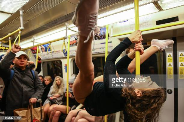 """People ride the District Line without trousers on January 12, 2020 in London, England. Originating as a prank on the New York Subway, the """"No Pants..."""