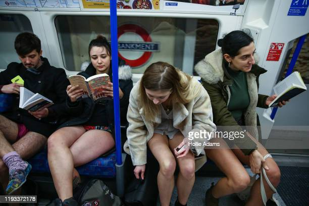 People ride the Northern Line without trousers on January 12 2020 in London England Originating as a prank on the New York Subway the No Pants on the...