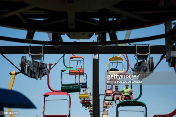 People ride the State Fare Flyer during the Got to Be NC Festival on the North Carolina State Fairgrounds on May 20 2017 in Raleigh North Carolina /...