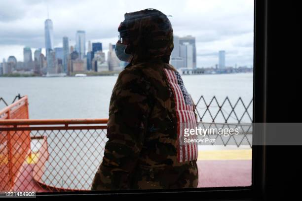 People ride the Staten Island Ferry, which commutes between Staten Island and Manhattan on April 27, 2020 in New York City. Hospitals in New York...