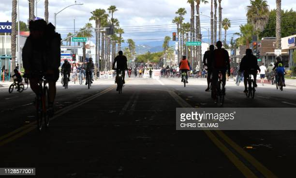 People ride their bikes under the freeway overpass in carfree streets during a CicLAvia event in Culver City on March 3 2019 CicLAvia is a nonprofit...