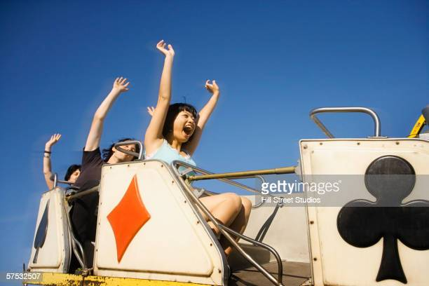 People riding a roller coaster