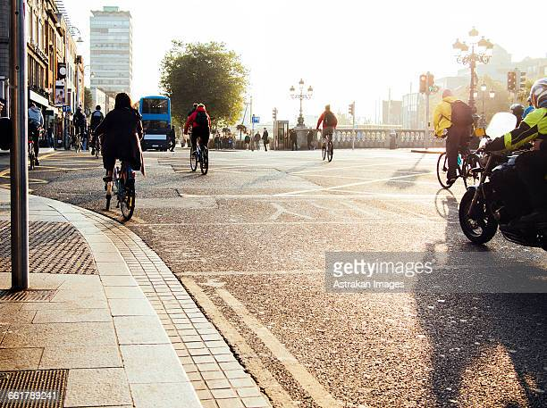 People riding bicycles on city street