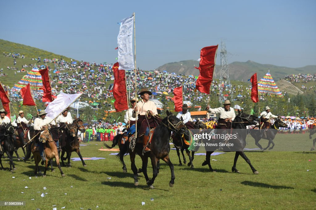 People riding horse perform during The 18th China nine color Gannan the Shambhala Tourism Arts Festival at Hezuo on July 17, in Gannan Tibetan Autonomous Prefecture, Gansu Province of China. The 18th China nine color Gannan the Shambhala Tourism Arts Festival kicked off on Monday morning in Hezuo city in Gannan. About a thousand people riding horses run across the grassland and over one thousand people perform the Guozhuang dance during the opening of the festival.