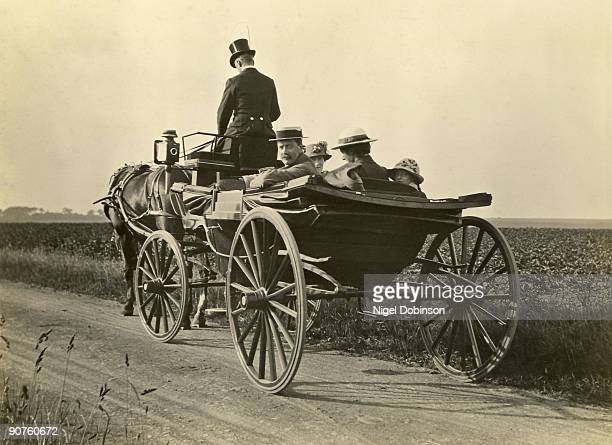 People riding in an open carriage England c 19011910