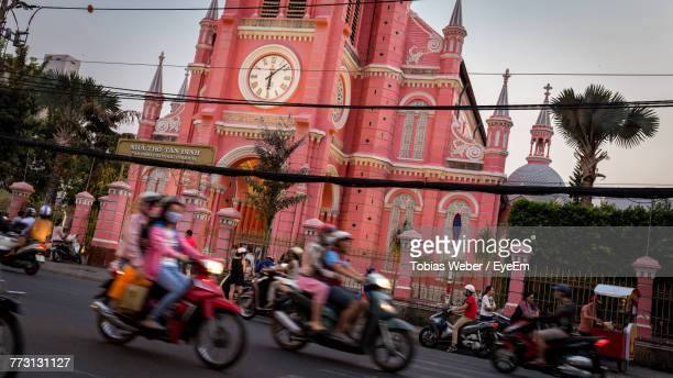 people riding motorcycles on street in city - ho chi minh city stock pictures, royalty-free photos & images