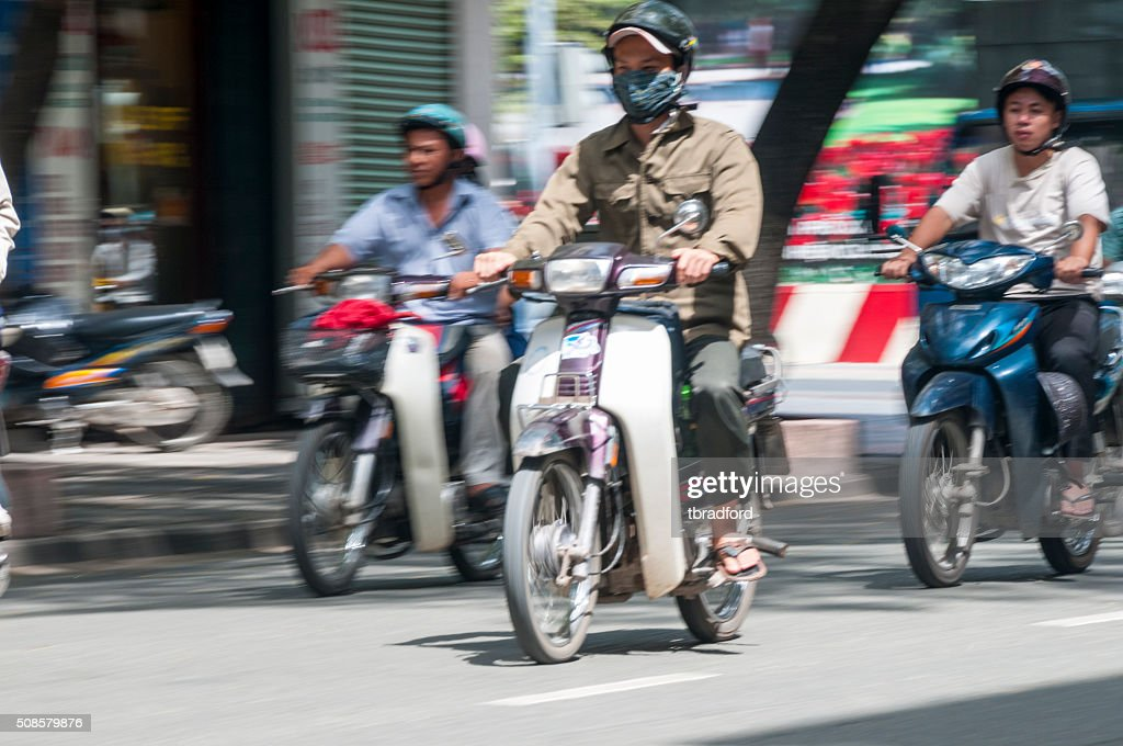 People Riding Scooters In Ho Chi Minh City, Vietnam : Stock Photo
