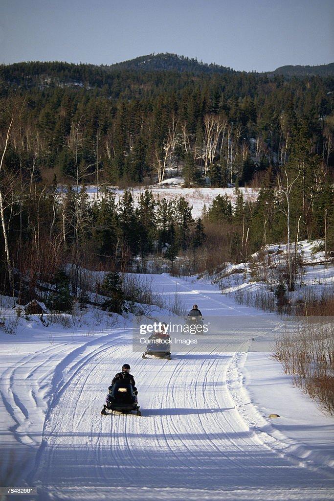 People riding snowmobiles : Foto de stock