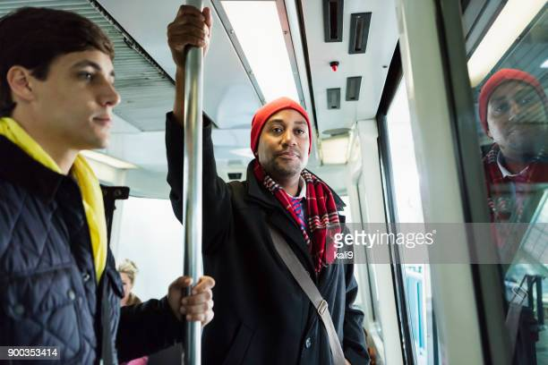 people riding train to work in winter - stranger stock pictures, royalty-free photos & images