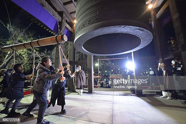 People ring the bell 101 times as they take part in the Joya no kaneat at Zojoji during the New Year celebrations in Tokyo Japan on December 31 2016
