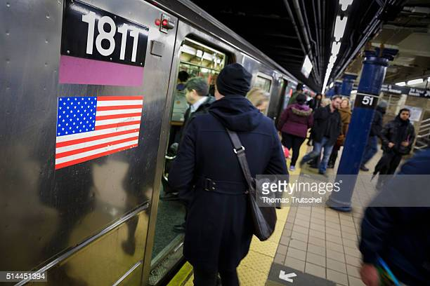 New York United States of America February 25 People rise in New York in a subway where the flag of the United States is fixed on February 25 2016 in...
