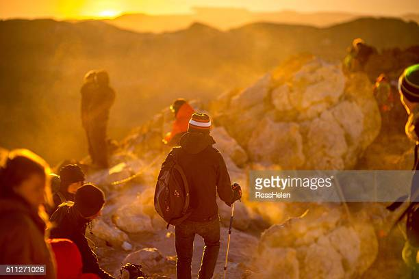 People rising up on the peak of volcano Teide