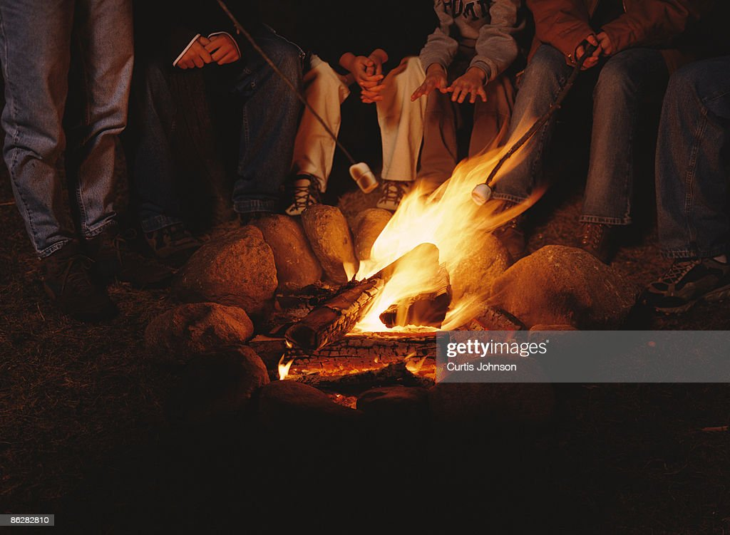 People Roasting Marshmallows Over Campfire Stock Photo