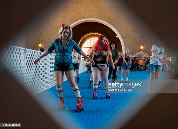 People roller skate after the historic Union Train Station was turned into a 1970's style disco skating rink in Los Angeles California on August 24...
