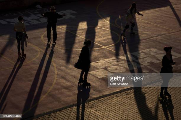 People roller-skate on the promenade on February 05, 2021 in Brighton, United Kingdom. Health authorities have found more than 100 cases of a...