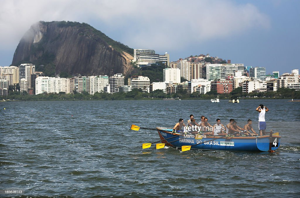 People row on the Rodrigo de Freitas Lagoon (Lagoa Rodrigo de Freitas) during the 1st World Press Briefing for the Rio 2016 Olympic Games on October 23, 2013 in Rio de Janeiro, Brazil. Preparations for the Rio 2016 Olympic Games are continuing and the lagoon will be used as the venue for rowing competitions during the Games.