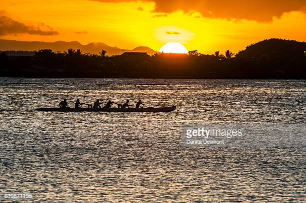 people rowing in of apia at sunset, upolu, samoa - apia stock photos and pictures