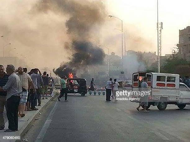 People run after a car bomb attack at 6 October area leaving many wounded and killed in Cairo Egypt on June 30 2015