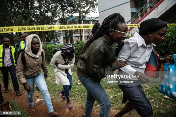 People run after being rescued from the Dusit Hotel on January 15 2018 in Nairobi Kenya A current security operation is underway after terrorists...