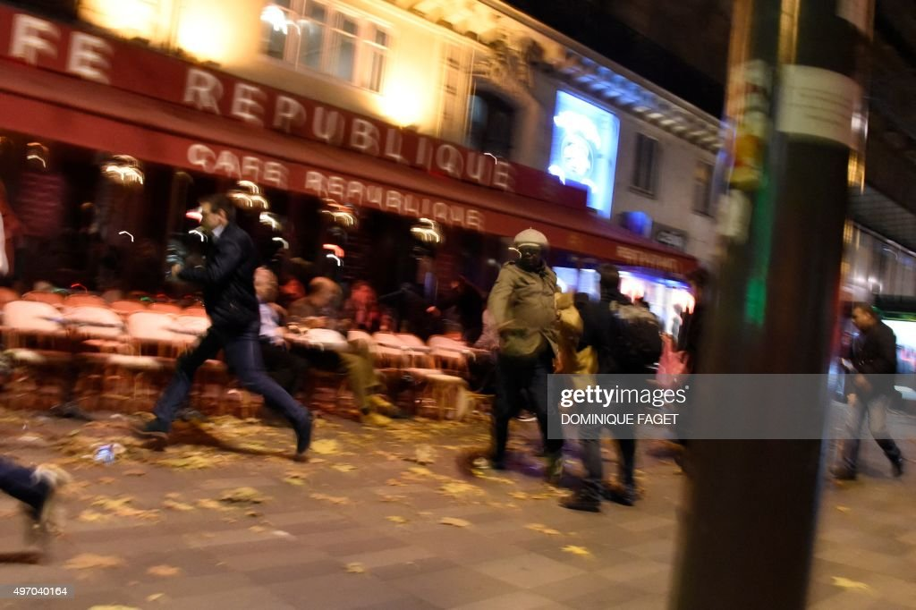 People run after hearing what is believed to be explosions or gun shots near Place de la Republique square in Paris on November 13, 2015. At least 18 people were killed in several shootings and explosions in Paris today, police said.