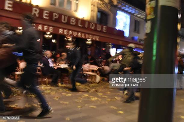 People run after hearing what is believed to be explosions or gun shots near Place de la Republique square in Paris on November 13, 2015. At least 18...