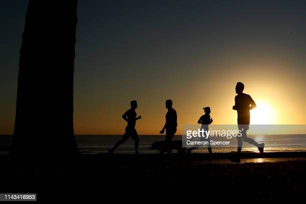People run along Manly Beach in the electorate of Warringah on April 18 2019 in Sydney Australia The electorate of Warringah is located in Sydney's...