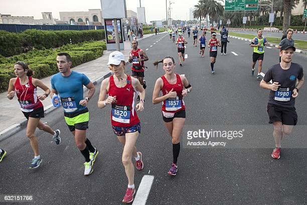 People run as they take part in the Standard Chartered Dubai Marathon 2017 in Dubai United Arab Emirates on January 20 2017